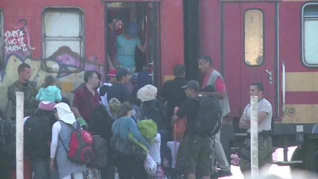 after crossing the border between greece and macedonia thousands of migrants head for a camp located near gevgelija to take the train to the serbian... - greece stock videos & royalty-free footage