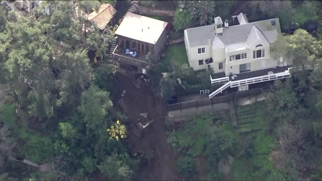 vídeos de stock, filmes e b-roll de after days of rain, a concrete balcony and foundation has fallen from a hillside home in the hollywood hills, and a related road closure has prompted... - major road