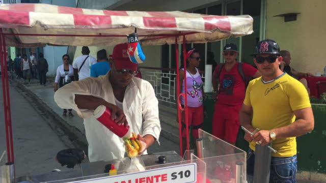 after economic changes in the caribbean island selling food in the streets is now legal and popular with entrepreneurs - the center stock videos and b-roll footage
