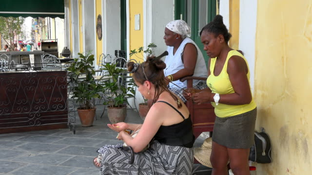 after economic changes selfemployed private business owners can charge directly to tourists visiting the caribbean island old havana is a unesco... - plaza vieja stock videos and b-roll footage