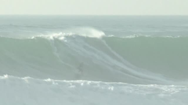stockvideo's en b-roll-footage met after escaping death in 2013 brazilian surfer maya gabeira has made her triumphant return to the giant waves in the seaside town of nazare in... - maya