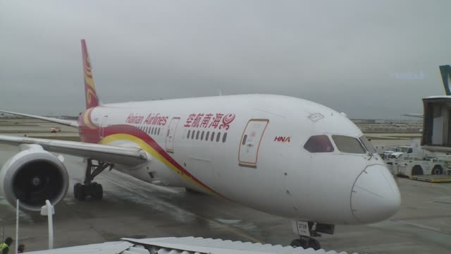 after flying over 11000 kilometers hainan airlines flight 497 which took off from beijing landed at chicago o'hare international airport at 1205 pm... - boeing 787 stock videos and b-roll footage