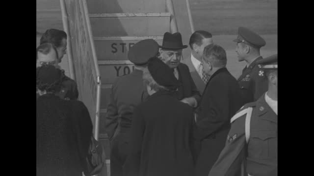 after getting off airplane at tokyo airfield us special envoy john foster dulles shakes hands with us general matthew ridgway commander of un forces... - matthew b. ridgway stock-videos und b-roll-filmmaterial