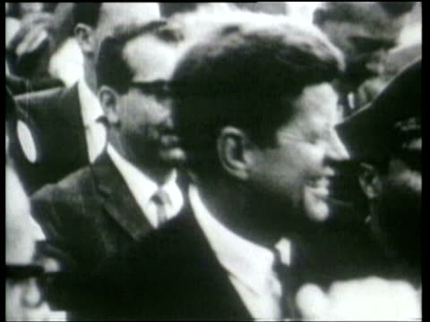 stockvideo's en b-roll-footage met after he was greeted by an enthusiastic mexican crowd john kennedy enjoys remarks in spanish by jacqueline kennedy to mexican president lopez mateos... - jacqueline kennedy