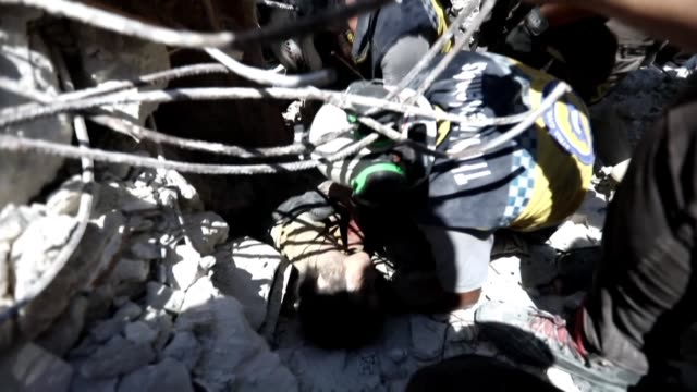 after hours of searching little batoul was rescued alive from under the rubble of her building by the rescuers of the syrian civil defence as rescue... - rescue worker stock videos & royalty-free footage