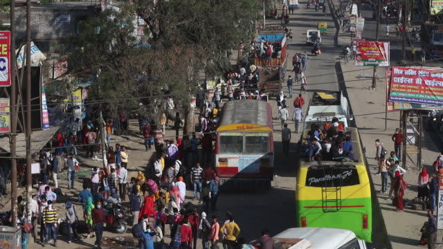 after india's lockdown announcement, huge number of laborers gathered and started walking to their villages. noida, delhi, india, on saturday, march... - passenger stock videos & royalty-free footage