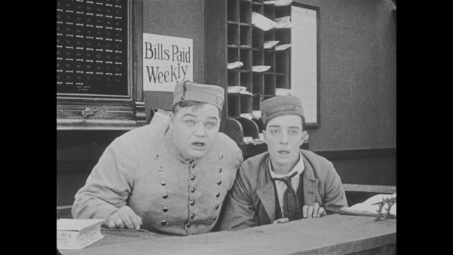 1918 after initially being frightened when a man who looks like a devil screams in his face, bellman (fatty arbuckle) plays a game of patty cake with him - fatty arbuckle stock videos and b-roll footage