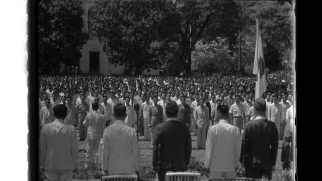 after instructions from an imperial japanese army officer young filipino prisoners in lines raise their right hands to symbolize a new fealty to the... - prisoner rehabilitation stock videos & royalty-free footage