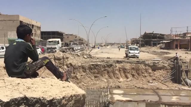 after iraqi authorities declared their victory against the islamic state group jihadists in mosul residents of the western parts of the city were... - civilian stock videos & royalty-free footage