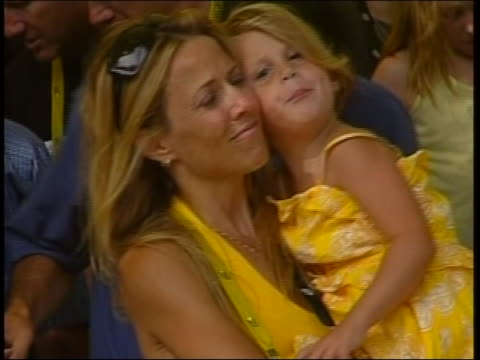 vidéos et rushes de after lance armstrong wins the tour de france, singer and actor, sheryl crow holds lance armstrong's daughter grace. - sport