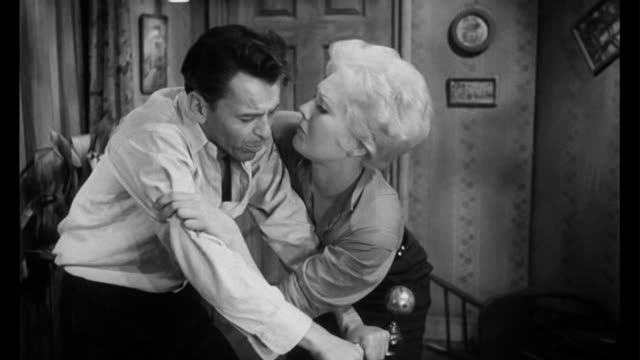 1955 After man (Frank Sinatra) tries to escape, woman (Kim Novak) locks him in a closet