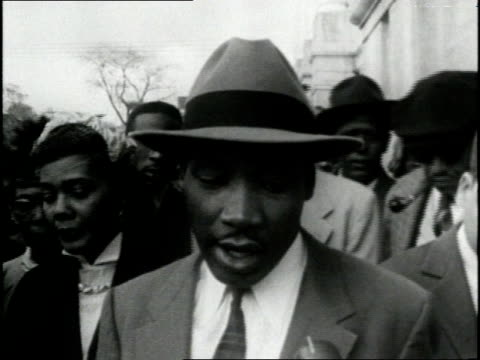 stockvideo's en b-roll-footage met after martin luther king jr speaks out against segregation and tells the press of nonviolent protests against segregation a court finds dr king... - 1956