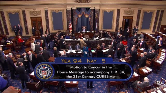 vidéos et rushes de after months of debate following on three years of crafting the legislation originating in the house a comprehensive biomedical research innovation... - united states congress