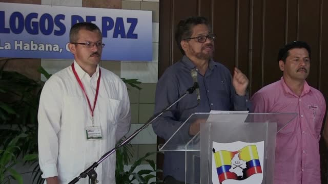 after months of discussions colombias government and farc guerrilla announce a rapprochement in their positions on a definitive ceasefire in colombia... - disarmament stock videos and b-roll footage