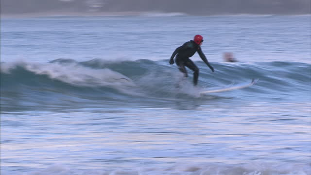 after more than 50 years riding the waves cornwall's godmother of surf remains inspirational to those who love the sport gwyn haslock is britain's... - godmother stock videos & royalty-free footage