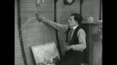 1921 after nailing hole in boat wall, man (buster keaton) nails pancake over leak to stem flow - slapstick comedy stock videos & royalty-free footage