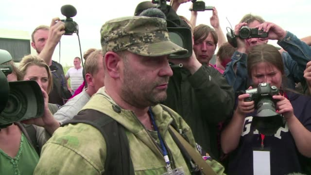 after negotiating with pro russia rebels a team of osce observers were able to visit the malaysia airlines crash site in ukraine - rebellion stock videos & royalty-free footage