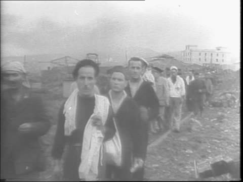 after pantelleria air assault locals liberated by invasion / british troops marching onto the island from ships / destruction on the island from... - sicily stock videos & royalty-free footage