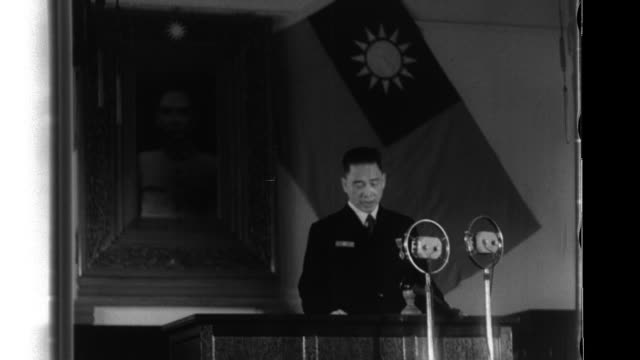 After President Wang addresses an audience at DaLiTang Hall at the Suang Shi Jie celebration he travels to Xiaorong Training Field where he reviews a...