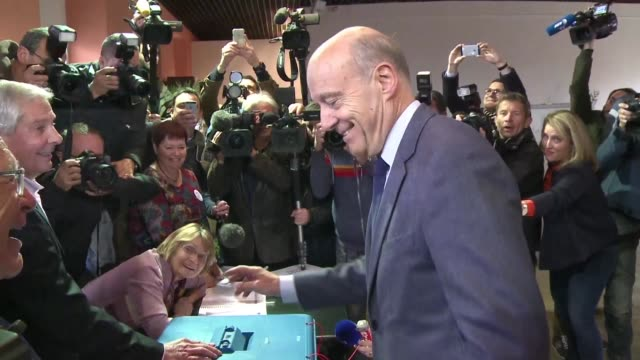 After queuing for over an hour Bordeaux mayor and presidential hopeful Alain Juppe cast his vote on Sunday in a primary election that is widely...