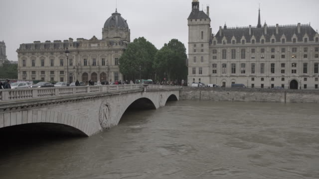 after several days of continuous rainfall seine river overflows docks in paris on june 1st 2016 - seine river stock videos and b-roll footage
