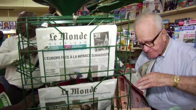 vídeos de stock, filmes e b-roll de after six days delay the most recent edition of the french satirical magazine charlie hebdo went on sale in ivory coast on monday - sátira