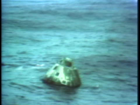 after splashdown, the apollo 13 spacecraft floats on the waters of the south pacific. - splashdown stock videos & royalty-free footage