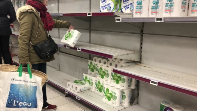 stockvideo's en b-roll-footage met after the announcement of the closure of schools due to coronavirus worried french begin to make food stocks at supermarket on march 14 2020 in... - shelf