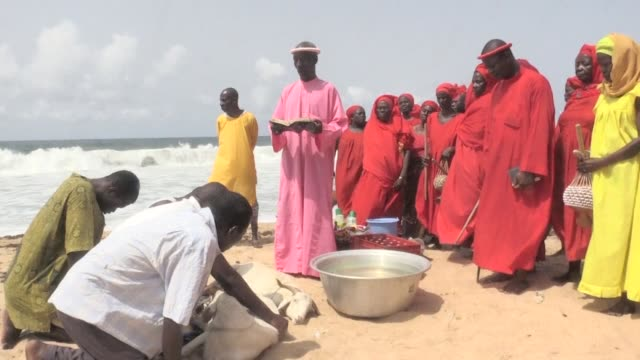 after the deadly terrorist attack that took place in grand bassam in ivory coast the city has organized a purification session of the beaches where... - côte d'ivoire stock videos & royalty-free footage