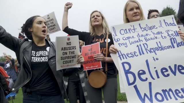 after the kavanaugh/ford hearing demonstrators exited the hart senate office building and marched to the steps of the us supreme court building where... - us supreme court building stock videos and b-roll footage