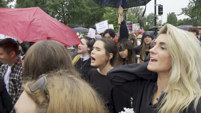 after the kavanaugh/ford hearing demonstrators exited the hart senate office building and marched to the steps of the us supreme court where they... - us supreme court building stock videos and b-roll footage