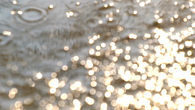 after the rain, raindrops with sun light in slow motion - puddle stock videos & royalty-free footage