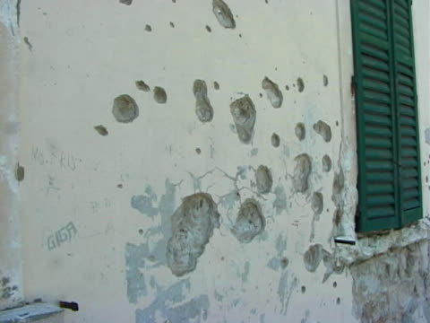 After the War: Bullet Holes in Wall, Pan to Bus