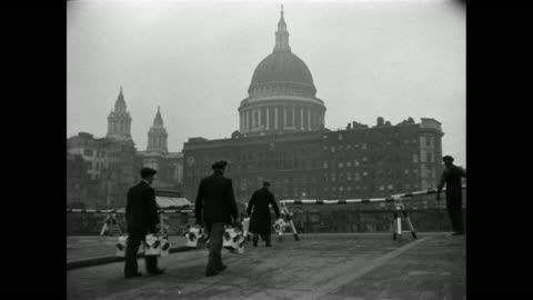 montage after the war, lighting restrictions are eased as workers are tending to streetlights near st. paul's cathedral / london, england, united kingdom - 1946 stock videos & royalty-free footage