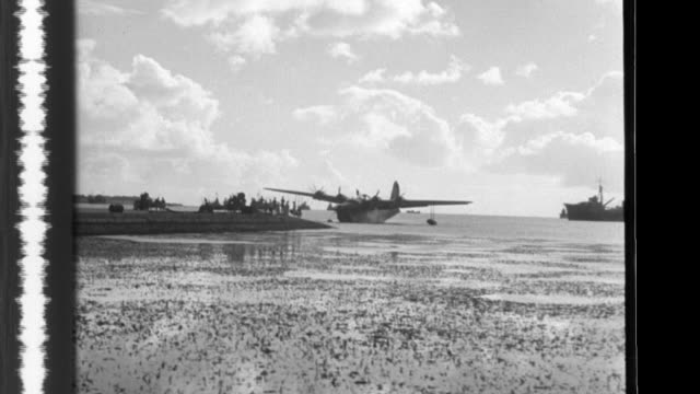 vídeos de stock, filmes e b-roll de after they receive instructions the crew of a type 2 flying boat takes off and and performs a scout and observation mission in support of a convoy - instruções