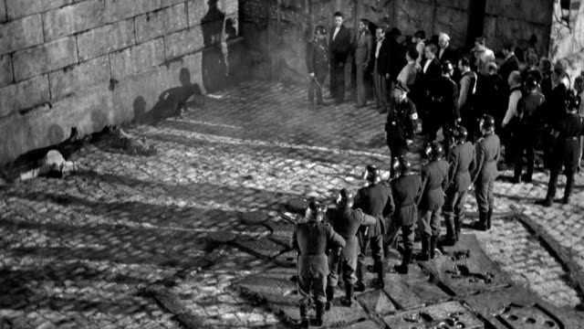 stockvideo's en b-roll-footage met after three prisoners are executed by a nazi firing squad, more prisoners are led forward. - nazism