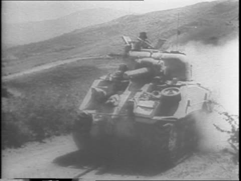 after three weeks the axis bastion of cantina falls to the combined operations of american british and canadian troops / gunfire in italian... - anno 1943 video stock e b–roll