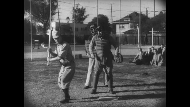 1927 after walking, athlete (buster keaton) gets stuck on first base - baseball bat stock videos & royalty-free footage