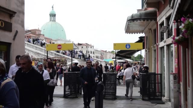after years of debate venice's mayor puts entrance gates in front of calatrava bridge and santa lucia station both key touristic points in order to... - mayor stock videos and b-roll footage