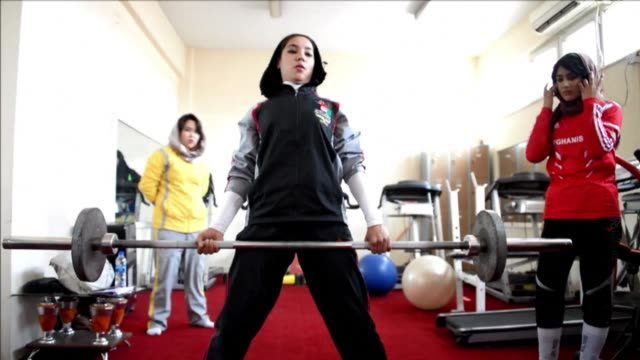 after years of oppression under the taliban afghan women are slowly heading to femaleonly gyms clean afghan women take to the gym away from th on... - taliban stock videos & royalty-free footage