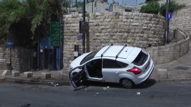 aftermath images of a car carrying israelis that was pelted with stones, lost control and rammed into palestinians, at jerusalem's lion's gate - middle eastern ethnicity stock videos & royalty-free footage