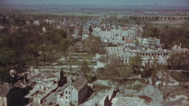 aftermath of air raid with incendiaries and damaged bridge over the main / frankfurt, germany - air raid stock-videos und b-roll-filmmaterial
