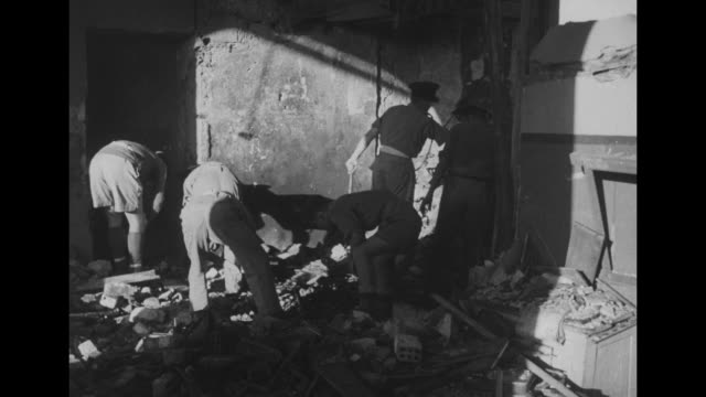 stockvideo's en b-roll-footage met aftermath of bombing at jerusalem railway station / british army digging through debris / train station signs / vs railway station / overhead view... - 1946