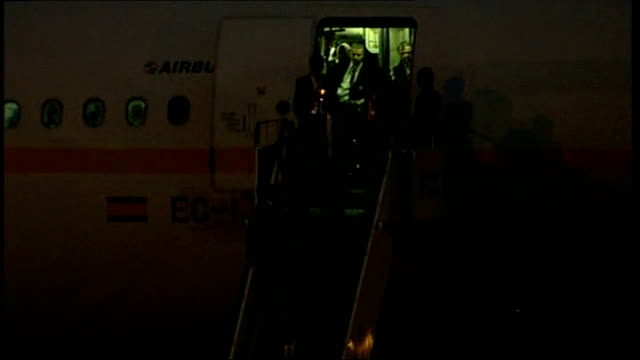 Aftermath of Champions' League final **FLASH Players seen distantly on steps of aircraft