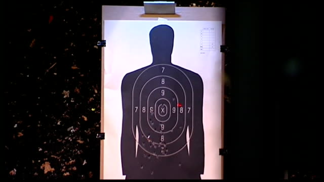 vídeos de stock, filmes e b-roll de gun sales surge / gun control debate reignited int various shots of people firing rifles and hand guns at range sot target with bullets hitting it... - pet equipment