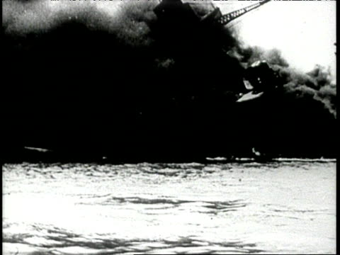 aftermath of pearl harbor attack ships burning in harbor wounded being tended to - anno 1941 video stock e b–roll