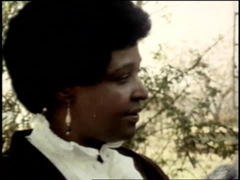 aftermath of police attack on winnie mandela's home / ruined interior and burned house, winnie mandela and daughter zindzi sift through the mess;... - 1985 stock-videos und b-roll-filmmaterial
