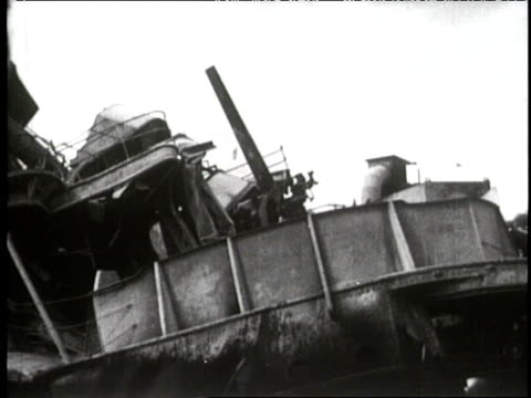 aftermath of the attack on pearl harbor - mangled wreckage of the uss arizona, naval cruiser passes by burning wreckage. - prelinger stock videos & royalty-free footage