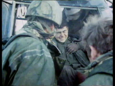 aftermath of the battle at goose green / argentine prisoners of war / soldiers carrying injured on stretchers, dead bodies placed aside / wreckage,... - 1982 stock videos & royalty-free footage