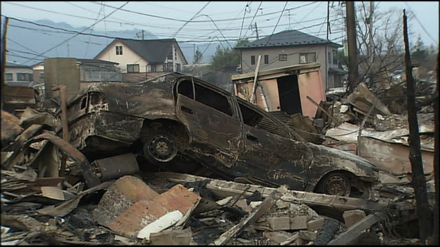 aftermath of the earthquake and tsunami completely destroyed streets as a result of fire following tsunami charred cars ember the 90 magnitude quake... - raw footage stock videos & royalty-free footage